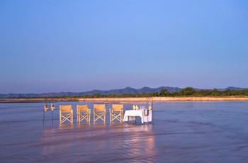 Sundowners set up in the Kapamba River, Zambia