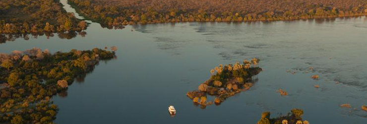 Sunset cruise on the upper Zambezi River above the Victoria Falls