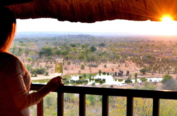 Victoria Falls Safari Lodge overlooks a waterhole