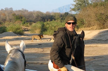 Viewing lions from horseback, near Kruger Park, South Africa